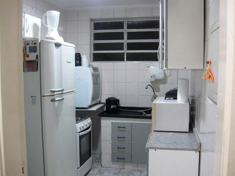 Jabaquara, Apartamento Padrão-Cozinha com piso de cerâmica, armários, teto com moldura de gesso e pia de granito.