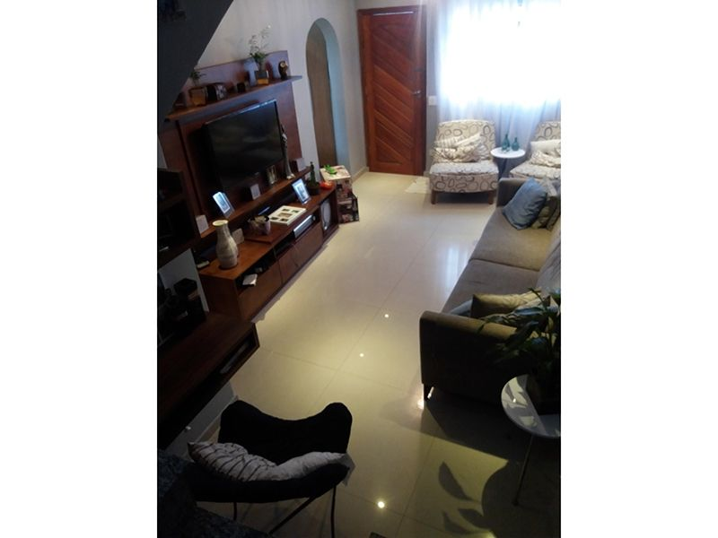 Jabaquara, Casa Térrea-Sala retangular com piso de porcelanato e teto de gesso rebaixado com iluminação embutida.