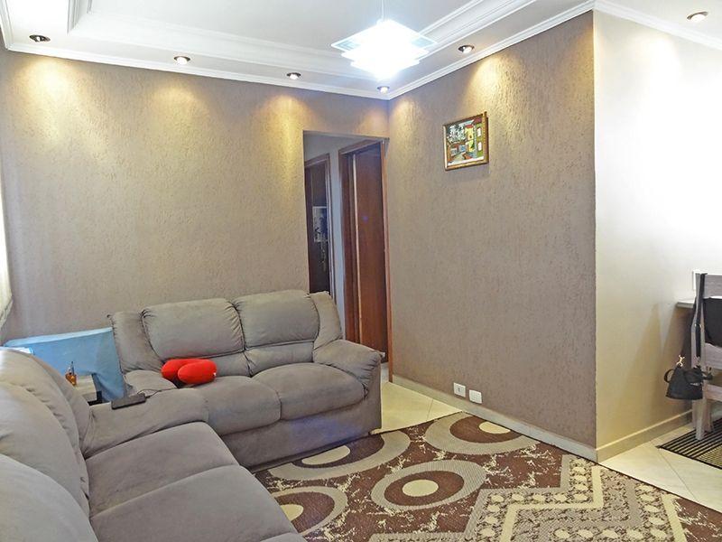 Sacomã, Apartamento Padrão-Sala retangular com ambientes, piso de porcelanato, parede com textura, teto com moldura de gesso e iluminação embutida.