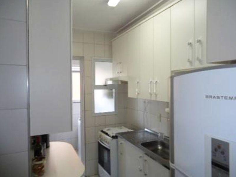 Jabaquara, Apartamento Padrão-Cozinha com piso de cerâmica, pia de granito com gabinete e armários.