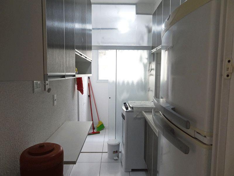 Ipiranga, Apartamento Padrão-Cozinha com piso de cerâmica, pia de mármore com gabinete e armários planejados.
