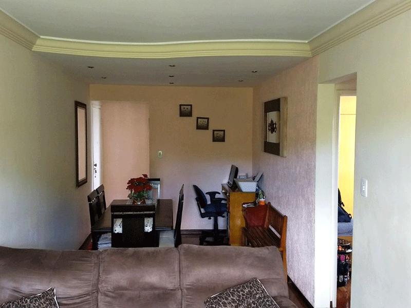 Jabaquara, Apartamento Padrão-Sala retangular com piso de madeira, teto com moldura de gesso e iluminação embutida.