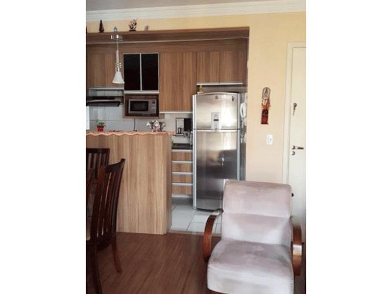 Sacomã, Apartamento Padrão-Cozinha americana integrado à área de serviço com piso de cerâmica, pia com gabinete e armários planejados.