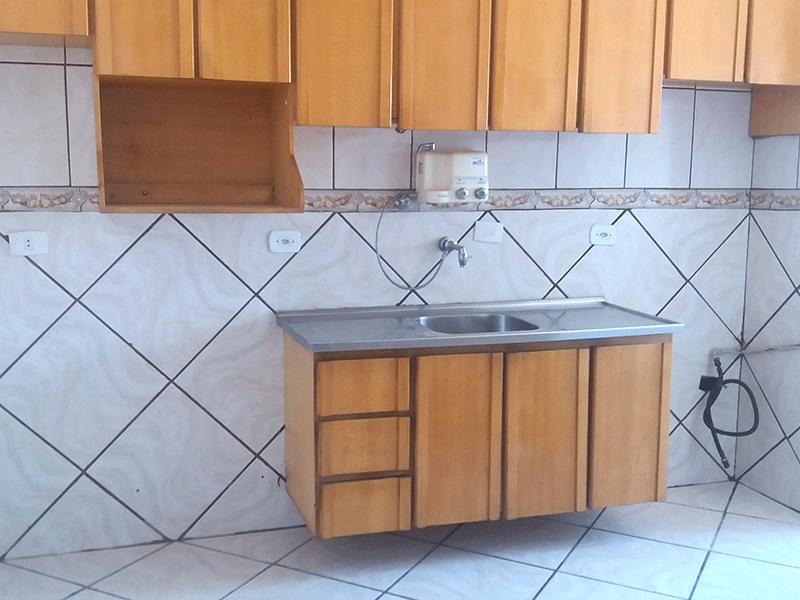 Jabaquara, Apartamento Padrão-Cozinha integrada com área de serviço, piso de cerâmica, pia de granito e armários planejados.