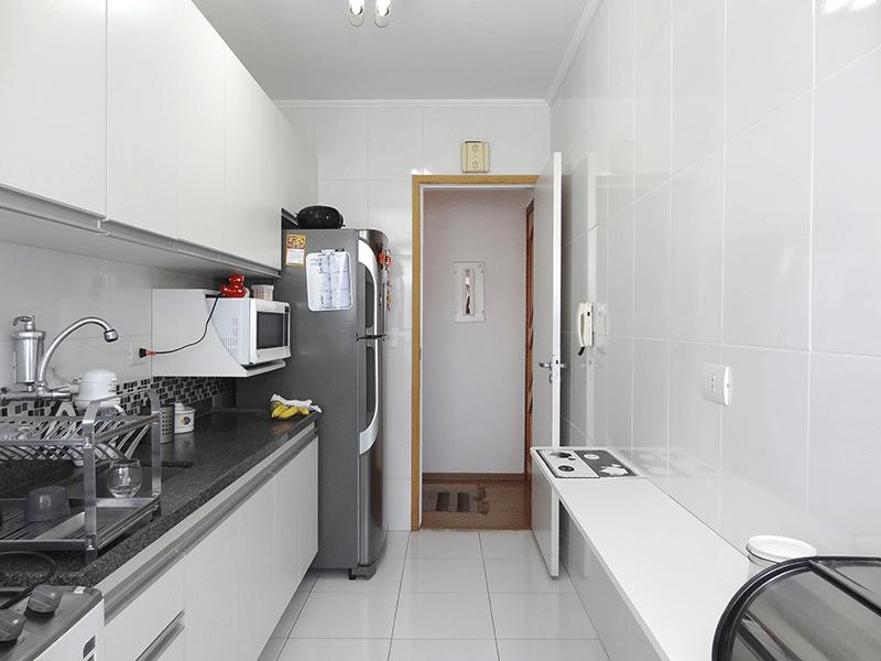 Jabaquara, Apartamento Padrão-Cozinha com piso de cerâmica, armários planejados e armários planejados.