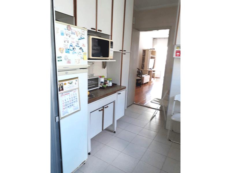 Jabaquara, Apartamento Padrão-Cozinha com piso de cerâmica e armários planejados.