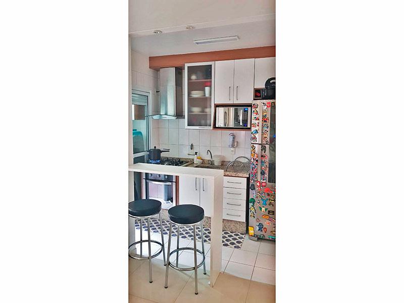 Ipiranga, Apartamento Padrão-Cozinha americana com piso de cerâmica, iluminação embutida, armários planejados, gabinete, cooktop, pia de granito e acesso a área de serviço.